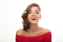 Closeup portrait of laughing young cute brunette woman with flower headpiece and cool makeup in read blouse looking into camera po Royalty Free Stock Photos