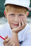 Closeup portrait of little artist. Closeup portrait of little boy in white t-shirt with red felt pen in his hand Royalty Free Stock Image