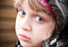 Closeup portrait of a little blond girl Stock Images