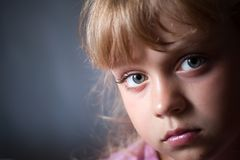 Closeup portrait of a little blond girl Stock Photos