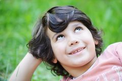 Closeup portrait of a little boy outside Royalty Free Stock Photo