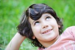 Closeup portrait of a little boy outside Royalty Free Stock Photo