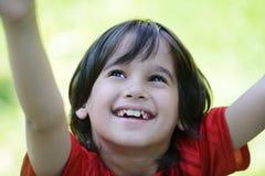 Closeup portrait of a little boy outside Stock Photos