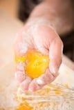 Closeup portrait of little child cooking egg Stock Image