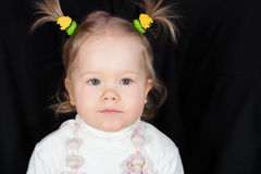 Closeup portrait of little girl with funny scrunchy. On the head royalty free stock photos