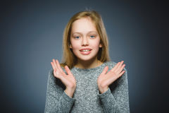 Closeup Portrait of little girl going surprise on gray background.  Royalty Free Stock Photos