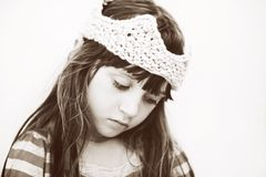 Closeup portrait of little girl in knitted crown Stock Photography