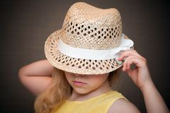 Closeup portrait of a little girl with straw hat stock photo
