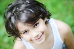 Closeup portrait of a little kid. Closeup portrait of a little happy boy outside stock photography