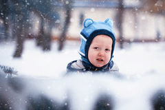 Closeup portrait Little winter baby boy, snowing Stock Image