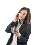 Closeup portrait of lovely young woman enjoying music using headphones Royalty Free Stock Photography