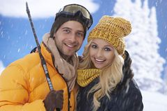 Closeup portrait of loving couple in snowfall Royalty Free Stock Photo