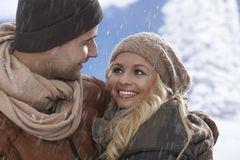 Closeup portrait of loving couple in snowfall Royalty Free Stock Image