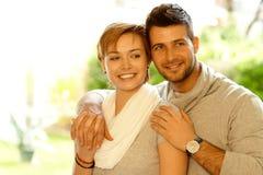 Closeup portrait of loving couple. Closeup portrait of young loving couple smiling, embracing, looking away stock photos
