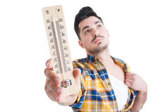 Closeup portrait of male holding a heat measurement instrument Royalty Free Stock Photography