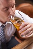 Closeup portrait of man drinking beer. Royalty Free Stock Image