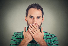 Closeup portrait man with hand over his mouth, speechless Stock Images