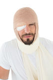 Closeup portrait of a man with head tied up in bandage Stock Image