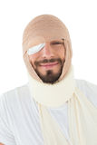 Closeup portrait of a man with head tied up in bandage Royalty Free Stock Photo