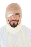 Closeup portrait of a man with head tied up in bandage Royalty Free Stock Image