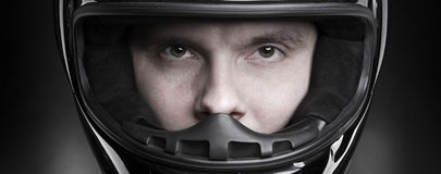 Closeup portrait of a man in helmet. Closeup portrait of a man`s eyes in helmet Royalty Free Stock Photography