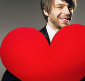 Closeup portrait of a man with a valentine's heart Stock Photos