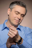 Closeup portrait of man wearing watches. Royalty Free Stock Photography