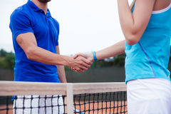 Closeup portrait of a man and woman handshaking Stock Photo