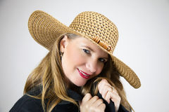 Closeup Portrait Mature Blonde Female Hat and Black Coat royalty free stock photography