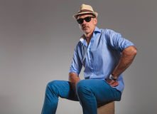 Closeup portrait with mature man in jeans wearing hat Stock Image
