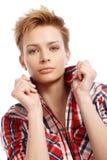 Closeup portrait of modern girl. Closeup portrait of modern short hair gingerish girl, turning-up collar Royalty Free Stock Image
