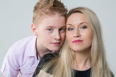 Closeup portrait of a mother and son. In the studio royalty free stock photo