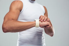 Closeup portrait of a muscular man using smartwatch Royalty Free Stock Image