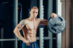 Closeup portrait of a muscular man workout with Royalty Free Stock Photo