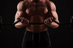 Closeup portrait of a muscular man workout with barbell at gym. stock photos
