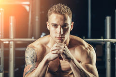 Closeup portrait of a muscular man workout with Royalty Free Stock Images