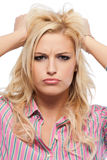 Closeup portrait of a nervous blonde woman Stock Photos