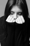 Closeup portrait of a nervous woman. Black and white closeup portrait of a nervous woman Royalty Free Stock Images