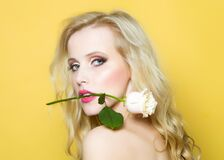 Free Closeup Portrait Of Beautiful Passionate Woman In Studio With Bare Shoulder And Brigt Makeup Holding Rose Flower In Stock Photos - 213038083