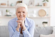 Free Closeup Portrait Of Beautiful Smiling Senior Lady Sitting On Couch At Home Stock Images - 185071494