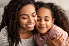 Free Closeup Portrait Of Black Mother And Daughter Hugging Stock Image - 214209871