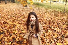 Free Closeup Portrait Of Cute Adorable Smiling Little Caucasian Girl Child Standing In Autumn Fall Park Outside, Looking In Camera, Royalty Free Stock Photos - 123534598