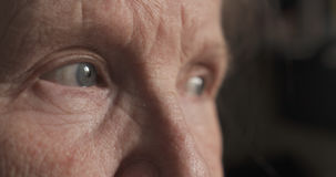 Closeup portrait of old womans eyes stock photo