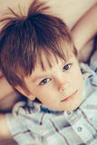 Closeup portrait of pensive little boy with brown eyes Stock Image
