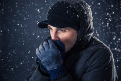 Closeup portrait of a pensive man with snow Stock Photo