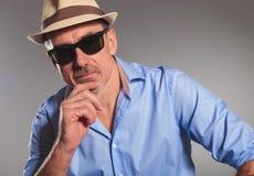 Closeup portrait of pensive mature man with open shirt Stock Photos