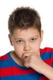 Closeup portrait of a pensive young boy Stock Images