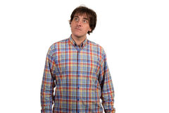 Closeup portrait of pensive young man in checkered shirt. Stock Photography