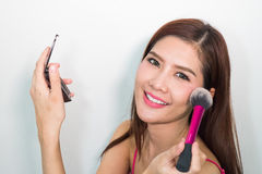 Closeup portrait picture of beautiful woman with brushes, royalty free stock images