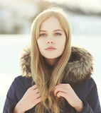 Closeup portrait of pretty blonde girl outdoors in winter Stock Images